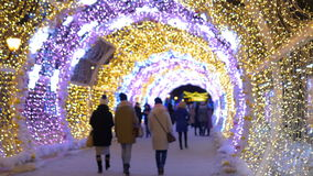 The tunnel of glowing lights. Decorating for Christmas stock footage