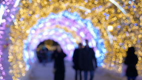 The tunnel of glowing lights. Decorating for Christmas. The tunnel of glowing lights. People walk on the streets decorated for Christmas stock video