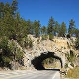 Tunnel going through rocks Stock Photos