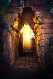 tunnel golden light in rock castle ancient royalty free stock images