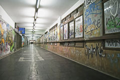 Tunnel with graffiti. Suburban underground tunnel with many graffiti on the walls Royalty Free Stock Photography