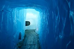 Tunnel in the ice inside Rhone glacier. Switzerland Royalty Free Stock Photography