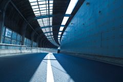 Tunnel inside of empty road surface floor Royalty Free Stock Photos