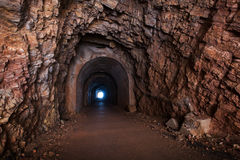 Tunnel interior perspective. With glowing end Stock Photography