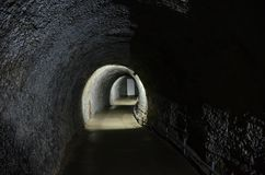 A tunnel leading to the door to the outside, in the Ice Cave in Kungur royalty free stock photo