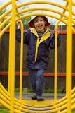 The Tunnel of Life. A young boy looking through a tunnel on a climbing frame royalty free stock images