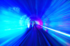 Tunnel of light. Background - traveling with the speed of light Royalty Free Stock Photography