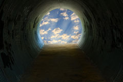 Tunnel with Light. A dark tunnel with light at the end Royalty Free Stock Image