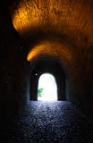 Tunnel light. Light at the end of an old stone tunnel. Castelo de Vide, Portugal Royalty Free Stock Photography