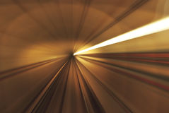 Tunnel Light Rail Transit. Slow speed shutter technique on fast train Royalty Free Stock Image