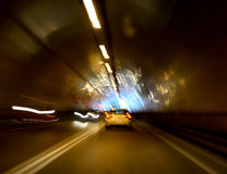 Tunnel with lights and moving cars Royalty Free Stock Photos