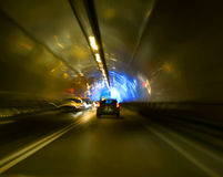 Tunnel with lights and moving cars Royalty Free Stock Photography