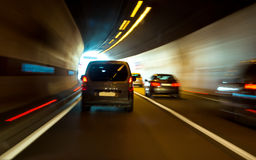 Tunnel with lights and moving cars Stock Photo