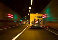 Tunnel with lights and moving cars Stock Image
