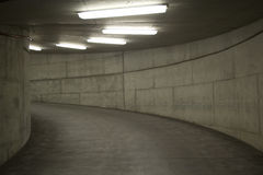 Tunnel Lights (Parking Garage). A concrete tunnel with lights (from a parking garage stock photo