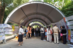 Tunnel of love. At matchmaking fair every Saturday morning in People`s Park, Shanghai, China, parents and grandparents scour profiles of eligible singles Stock Photography