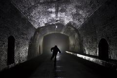 Uomo che tunning dalla luce Fotografie Stock