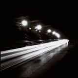 Tunnel med rörande trafikljus i svartvitt royaltyfri fotografi