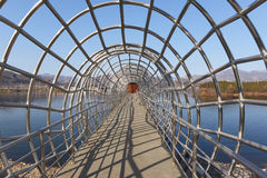 Tunnel with metal grid Stock Images