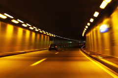 Tunnel in motion. Car trails in motion through a tunnel Stock Photo