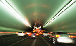 Tunnel motion blur. Motion blur inside tunnel on the way out to a bridge Royalty Free Stock Images