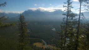 Tunnel mountain banff. Cliff side tunnel  mountain Banff forest tree over looking the   banff sunrise Stock Photography