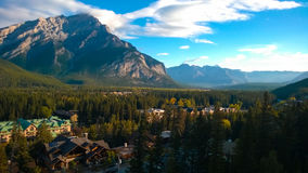 Tunnel mountain banff. Cliff side tunnel  mountain Banff forest tree over looking the town of banff sunrise Stock Photo