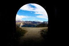 Tunnel and mountains Royalty Free Stock Image