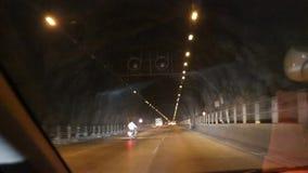 Tunnel on Mumbai-Pune express way. Passing through a tunnel on Mumbai-Pune express way by a car stock footage