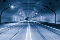 Tunnel at night. Tunnel with tram tracks at night with blue cast Royalty Free Stock Photo