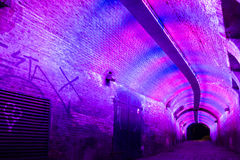 Tunnel by night in Utrecht, Netherlands. Purple and pink illuminated Ganzemarkt tunnel to Oudegracht in the old city centre of Utrecht, Netherlands Stock Photography