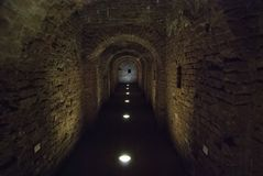 Tunnel of the old fortress. Stone passage in the tunnel of the old fortress Stock Photo