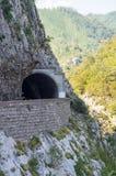 Tunnel over the precipice in Montenegro Stock Photos