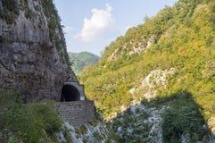 Tunnel over the precipice, Montenegro stock photography