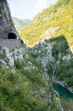 Tunnel over the precipice in Montenegro royalty free stock photos