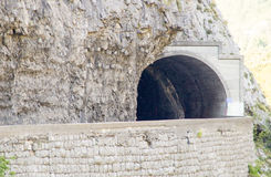 Tunnel over the precipice in the mountain of Montenegro royalty free stock photography