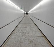 White tunnel. A tunnel or a passageway with white walls and ceiling Stock Images