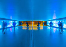 Tunnel with pedestrians in motion Royalty Free Stock Photo
