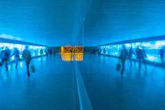 Tunnel with pedestrians in motion Stock Images