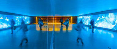 Tunnel with pedestrians in motion Stock Photo
