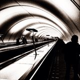 Tunnel. People on the escalator. Picture taken and edited by Apple iPhone 5 stock photography