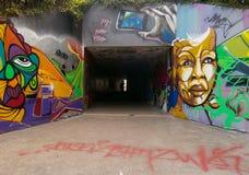Tunnel piétonnier avec le graffiti Photos stock