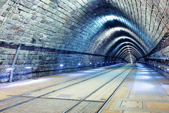 Tunnel with railroad and tram Stock Images