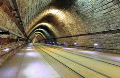 Tunnel with railroad and tram Royalty Free Stock Photography
