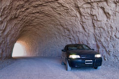 Tunnel road. In solid rock with car stock photos