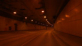 Tunnel road at night. Tunnel road in a city at night stock video footage