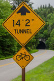Tunnel Road Sign with Tunnel in Background. A sign warns cars and bikers of a tunnel coming up along the Blue Ridge Parkway royalty free stock photos
