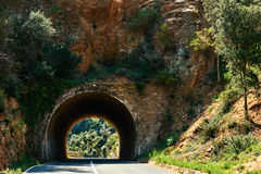 Tunnel through the rock Stock Images