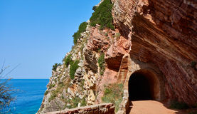 Tunnel. In the rock near Petrovac town, Montenegro Stock Images