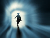 Tunnel run. Editable  silhouette of a woman running in a tunnel with background made using a gradient mesh Stock Image